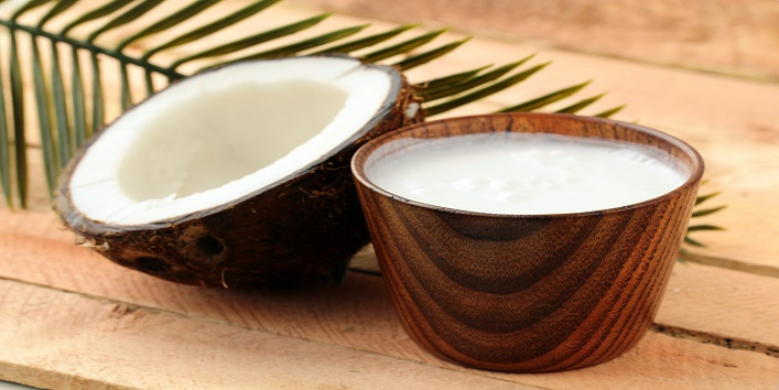 Coconut and coconut milk with palm branch