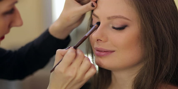 Use brush to apply concealer